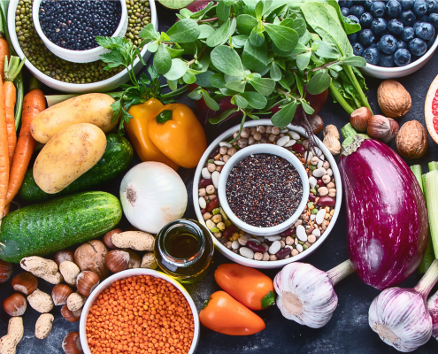 a photo of a large range of legumes, beans, nuts, fruit and vegetables that are commonly recommended by dietitians